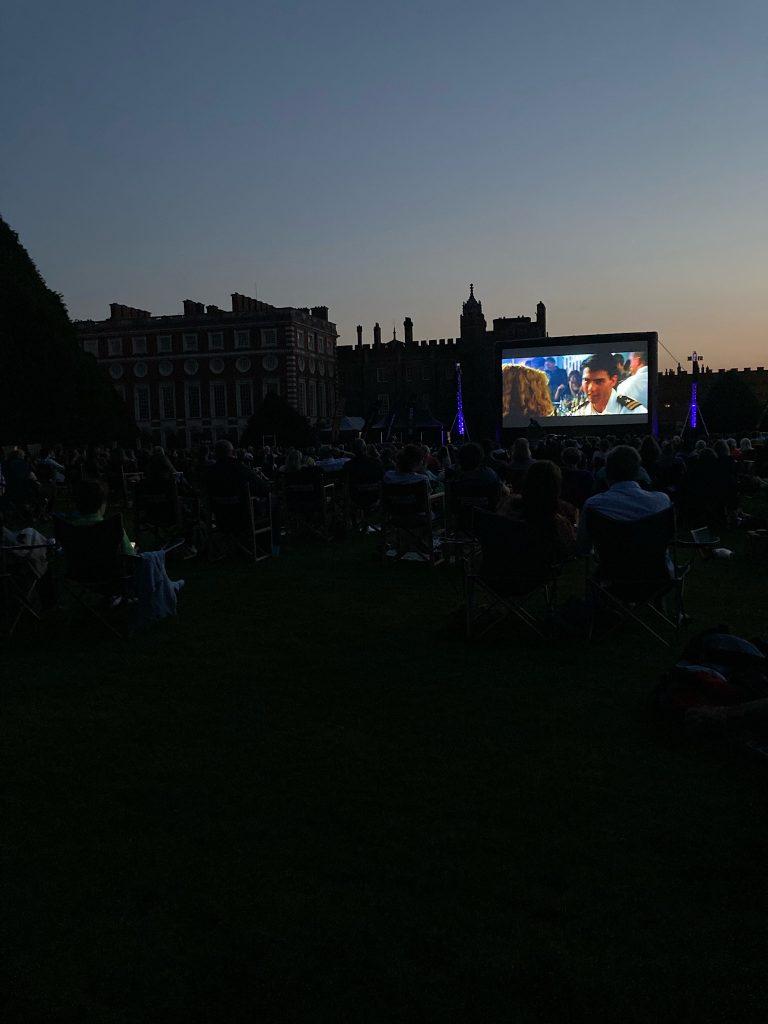 Open air cinema, at Hampton Court at night.